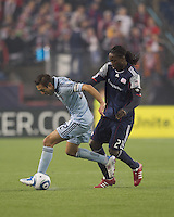 Sporting Kansas City midfielder Davy Arnaud (22) dribbles as New England Revolution midfielder Shalrie Joseph (21) pressures. In a Major League Soccer (MLS) match, the New England Revolution defeated Sporting Kansas City, 3-2, at Gillette Stadium on April 23, 2011.