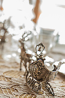 Austrian silver Stags and sleighs on the set table for dinner in the livingroom at Cà dei Frassini in Cortina d'Ampezzo