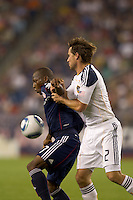New England Revolution midfielder Sainey Nyassi (17) attempts to control the ball as Los Angeles Galaxy defender Todd Dunivant (2) pressures. The New England Revolution defeated LA Galaxy, 2-0, at Gillette Stadium on July 10, 2010.