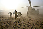U.S. soldiers from Company C, 2nd Battalion, 508th Parachute Infantry Regiment and Afghan police exit from a CH-47 Chinook helicopter after landing outside the village of Shuyene Wusa, in the Arghandab valley near Kandahar, Afghanistan. April 10, 2010. DREW BROWN/STARS AND STRIPES