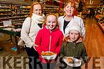 Aine, Seána and Anne Walsh from Cordal sampling food from Elaine Riordan at the Garveys Supervalu Castleisland's Food Fair on Tuesday.