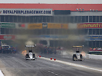 Apr 26, 2015; Baytown, TX, USA; NHRA top fuel driver Antron Brown (left) races alongside Tony Schumacher during the Spring Nationals at Royal Purple Raceway. Mandatory Credit: Mark J. Rebilas-