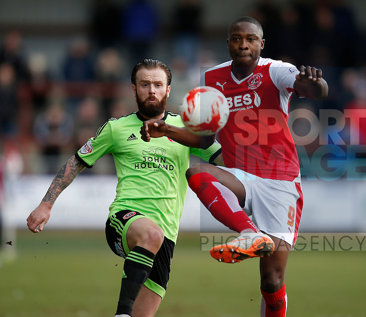 John Brayford of Sheffield Utd tussles with Shola Ameobi of Fleetwood Town  - English League One - Fleetwood Town vs Sheffield Utd - Highbury Stadium - Fleetwood - England - 5rd March 2016 - Picture Simon Bellis/Sportimage