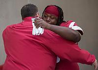 Hawgs Illustrated/BEN GOFF <br /> Bret Bielema, Arkansas head coach, hugs defensive lineman Bijhon Jackson during recognition of senior players before the game against Missouri Friday, Nov. 24, 2017, at Reynolds Razorback Stadium in Fayetteville.