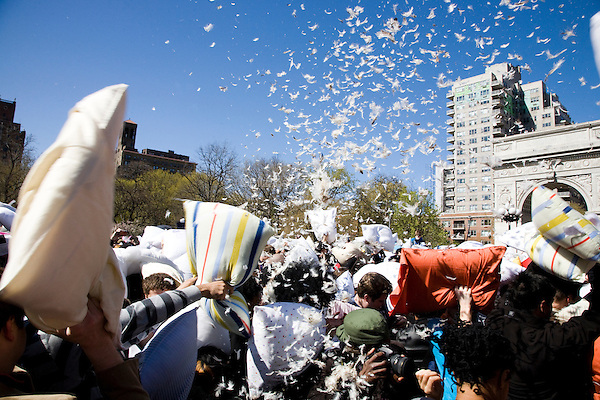 A massive pillow fight in celebration of International Pillow Fight Day at Washington Square Park in New York City, New York on 07 April 2012.