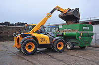 Tipping molasses into a Keenan Easi-Feeder using a JCB 526 loader, Chipping, Lancashire..Copyright..John Eveson,.Dinkling Green Farm,.Whitewell,.Clitheroe,.Lancashire..BB7 3BN.Tel. 01995 61280.Mobile 07973 482705.j.r.eveson@btinternet.com.www.johneveson.com