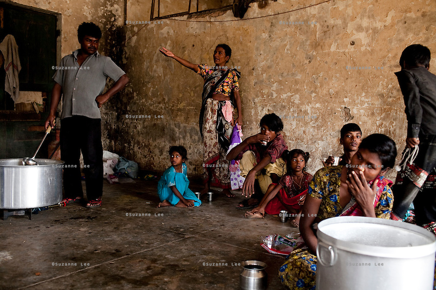 Underaged rape victim, 6 year old Mammarani (center, in blue) waits for tea at the 3 story abandoned building that has been made into the Motiakhan Shelter for homeless people, in Paharganj on 5th October 2010, in Old Delhi, India. Picture: Suzanne Lee for The Australian.