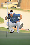 Lee Westwood lines up his putt on the 18th green during  Day 3 at the Dubai World Championship Golf in Jumeirah, Earth Course, Golf Estates, Dubai  UAE, 21st November 2009 (Photo by Eoin Clarke/GOLFFILE)