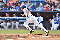 Asheville Tourists first baseman Chad Spanberger (24) runs to first base during a game against the Greensboro Grasshoppers at McCormick Field on May 11, 2018 in Asheville, North Carolina. The Tourists defeated the Grasshoppers 10-5. (Tony Farlow/Four Seam Images)