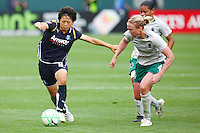Aya Miyama #8 of the Los Angeles Sol pushes the ball up the field against Sara Larsson #4 of St. Louis Athletica during their WPS game at Home Depot Center on May 30, 2009 in Carson, California. LA Sol defeated  St. Louis Athletic 2-0.
