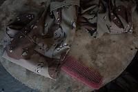 IRAK, Sheik Amir;A comb and a denim of a Daesh member in a house of  the town of Sheik Amir liberated by the Peshmerga, the 6th December 2016. <br /> <br /> IRAK, Sheik Amir; Un peigne et un treillis d'un membre de Daesh dans une maison de la ville de Sheik Amir lib&eacute;r&eacute; par les Peshmerga, le 6 d&eacute;cembre 2016.