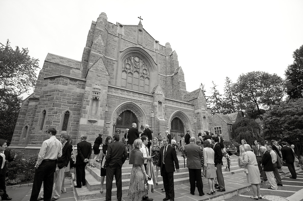 Black & white photo of the church and guests standing outside before the ceremony.