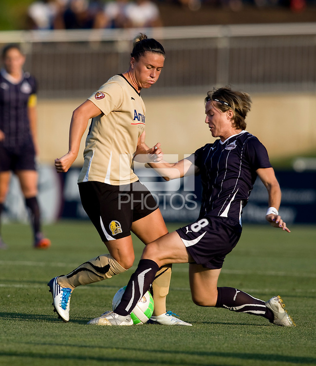 Kristen Graczyk (13) of FC Gold Pride fights for the ball with Sonia Bompastor (8) of the Washington Freedom at the Maryland SoccerPlex in Boyds, Maryland. FC Gold Pride defeated the Washington Freedom, 4-1.