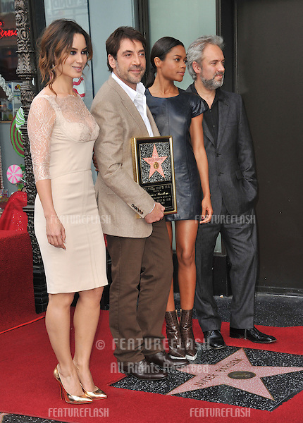 Javier Bardem & Bond Girls Berenice Marlohe & Naomie Harris (right) & director Sam Mendes on Hollywood Boulevard where he was honored with the 2,484th star on the Hollywood Walk of Fame..November 8, 2012  Los Angeles, CA.Picture: Paul Smith / Featureflash