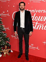 "20 November 2019 - Hollywood, California - Kristoffer Polaha. Hallmark Channel's 10th Anniversary Countdown to Christmas - ""Christmas Under the Stars"" Screening and Party. Photo Credit: Billy Bennight/AdMedia"
