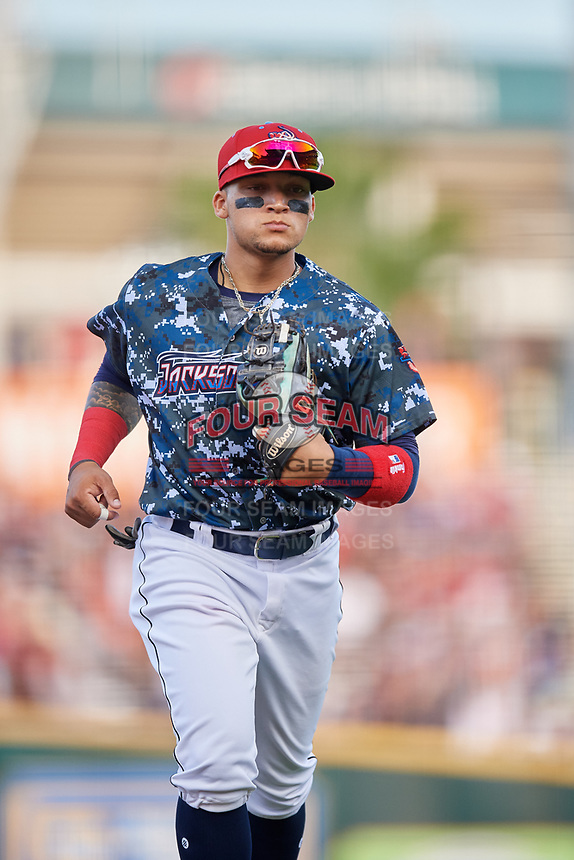 Jacksonville Jumbo Shrimp second baseman Isan Diaz (11) jogs off the field during a game against the Mobile BayBears on April 14, 2018 at Baseball Grounds of Jacksonville in Jacksonville, Florida.  Mobile defeated Jacksonville 13-3.  (Mike Janes/Four Seam Images)