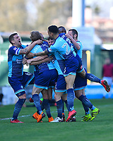 Wycombe Wanderers players mob goalscorer Randell Williams  during Yeovil Town vs Wycombe Wanderers, Sky Bet EFL League 2 Football at Huish Park on 14th April 2018
