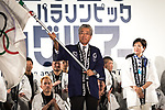 TOKYO, JAPAN - JULY 24: President of Olympic Committee (JOC) Tsunekazu Takeda waves an Olympic flag applauded by Japanese athletes during the Tokyo 2020 flag tour festival for the 2020 Games at Tokyo Metropolitan Plaza in Tokyo, July 24, 2017. Japan began its three-year countdown for the Tokyo 2020 Summer Olympics in Tokyo on Monday with image projection-mapping beamed on a building of Tokyo Metropolitan Government Office. The 2020 Games will be Japan's first summer Olympics since 1964. (Photo by Richard Atrero de Guzman/AFLO)