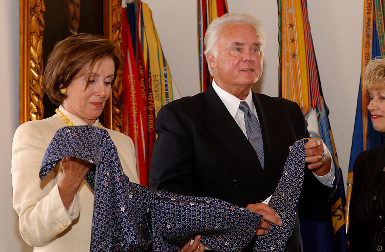 necktie1_090402 -- Nancy Pelosi, D-CA., and  C.W. (Bill) Young, R-FL., check out limited-edition ties and scarves in remembrance of September 11 attacks on the U.S. The ties and scarves were done by the White House Commission on Remembrance.