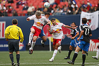 New York Red Bulls forward John Wolyniec (15) and midfielder Claudio Reyna (10) battle for the ball with San Jose Earthquakes midfielder Ramiro Corrales (12). The New York Red Bulls defeated the San Jose Earthquakes 2-0 during a Major League Soccer match at Giants Stadium in East Rutherford, NJ, on April 27, 2008.