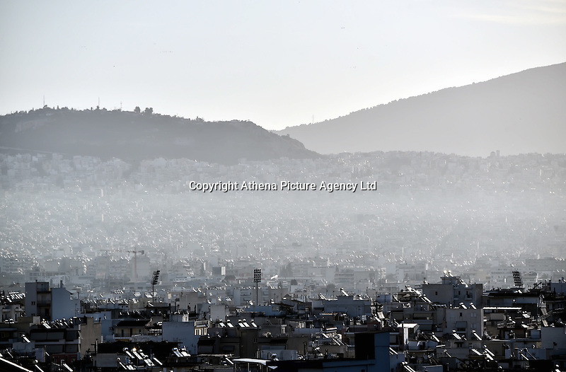 Pictured: Smog in Athens, Greece STOCK PICTURE<br /> Re: Diesel cars and trucks will be banned in Paris, Madrid, Athens and Mexico City by 2025 as part of a groundbreaking initiative to curb pollution.<br /> At a climate meeting in Mexico, the cities' mayors also pledged to incentivise electric, hybrid and hydrogen vehicles, and walking and cycling.<br /> The move comes amid increasing concerns about the impact of diesel engines on the health of people living in cities. <br /> Last week a report found that air pollution causes nearly half a million premature deaths each year in Europe alone.