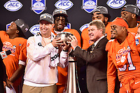 Charlotte, NC - DEC 2, 2017: Clemson Tigers head coach Dabo Swinney receives the tophy after winning the ACC Championship game over Miami 38-3 at Bank of America Stadium Charlotte, North Carolina. (Photo by Phil Peters/Media Images International)
