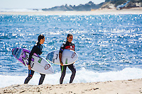 Margaret River, Western Australia. (Thursday April 3, 2014) Rip Curl team Manager  and caddy Brooke Farris (AUS) with Tyler Wright (AUS) after her heat win. –  The 2014 Drug Aware Margaret River Pro World Championship Tour event continued today in 3'- 6' surf at Surfers Point.  The men's event was called oof for the day while the Women's contest completed  Rounds 2  through to Round 4 were in the good clean conditions.   Photo: joliphotos.com