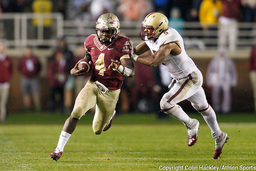 Florida State University Seminoles Dalvin Cook is pushed out of bounds by Boston College Eagles Ty-Meer Brown during the football game in Tallahassee, Florida on November 22, 2014. <br /> Colin Hackley/Athlon Sports
