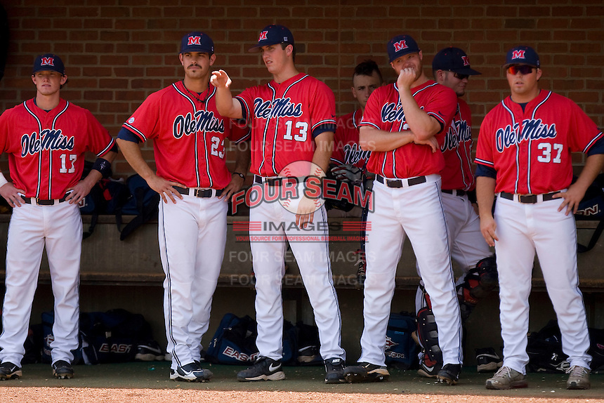 Drew Pomeranz #13 of the Ole Miss Rebels and his teammates watch the action from the dugout against the St. John's Red Storm at the Charlottesville Regional of the 2010 College World Series at Davenport Field on June 6, 2010, in Charlottesville, Virginia.  The Red Storm defeated the Rebels 20-16.  Photo by Brian Westerholt / Four Seam Images