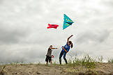 USA, Washington State, Long Beach Peninsula, a brother and sister battle with their kites at the International Kite Festival