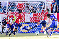 KC Wizards forward Kei Kamara takes a shot on goal past Chivas USA players Paulo Nagamura (l) and Michael Umana (r) and Ben Zemanski (rear). The Kansas City Wizards defeated CD Chivas USA 2-0 at Home Depot Center stadium in Carson, California on Sunday September 19, 2010.
