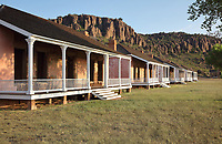 Officers' Row, living quarters for the army officers, at Fort Davis National Historic Site, a US army fort established 1854, in a canyon in the Davis Mountains in West Texas, USA. The fort was built to protect emigrants, mail coaches, and freight wagons on the trails through the State from Comanche and Apache Indians. After the Civil War, several African-American regiments were stationed here. By the 1880s, the fort consisted of one 100 buildings, housing over 400 soldiers. It was abandoned in 1891, but many buildings have been restored and the compound now operates as a historical site and museum. Picture by Manuel Cohen