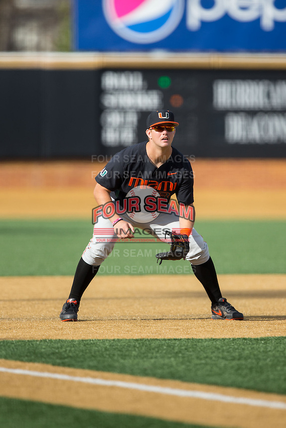 Miami Hurricanes third baseman David Thompson (8) on defense against the Wake Forest Demon Deacons at Wake Forest Baseball Park on March 21, 2015 in Winston-Salem, North Carolina.  The Hurricanes defeated the Demon Deacons 12-7.  (Brian Westerholt/Four Seam Images)