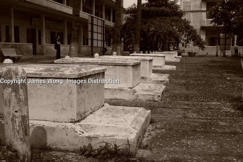 Phnom Penh,Cambodia - 2007 File Photo -<br /> <br /> victims graves,Tuol Sleng, former Khmer Rouge S-21 prison.<br /> <br /> The Tuol Sleng Genocide Museum is a museum in Phnom Penh, capital of Cambodia. The site is a former high school which was used as the notorious Security Prison 21 (S-21) by the Khmer Rouge regime from its rise to power in 1975 to its fall in 1979. Tuol Sleng in Khmer means &quot;Hill of the Poisonous Trees&quot; or &quot;Strychnine Hill&quot;.<br /> <br /> photo : James Wong-  Images Distribution