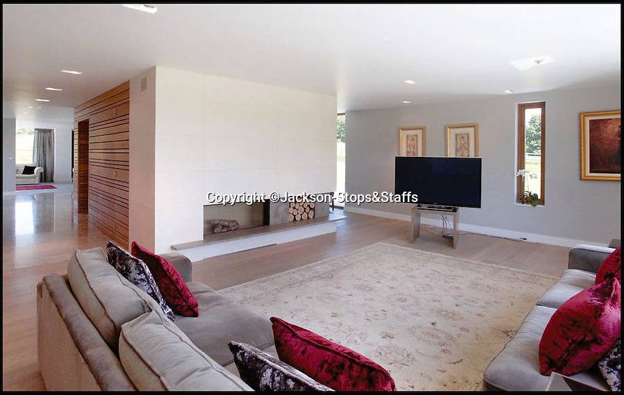 BNPS.co.uk (01202 558833)<br /> Pic: Jackson-Stops&Staff/BNPS<br /> <br /> Lounge in the main house.<br /> <br /> For sale - Super home with its own leisure centre attached.<br /> <br /> The buyers of this stunning country property will never need to leave home again - with their own leisure complex at their fingertips.<br /> <br /> Birchwood House in Hoar Cross, Staffs, is a bespoke five-bedroom house that makes the most of the incredible countryside surrounding it with floor to ceiling windows in most rooms.<br /> <br /> But the really unusual selling feature is its unsurpassed leisure suite with a purpose-built gym, 15-metre swimming pool, sauna and steam room. <br /> <br /> It might save you a fortune in gym fees, but any wannabe owners will need £2.75million to get their hands on this cutting edge, contemporary pad.<br /> <br /> The house also has a media room which currently has a pool table and a home cinema, meaning you really could settle in for the long haul.