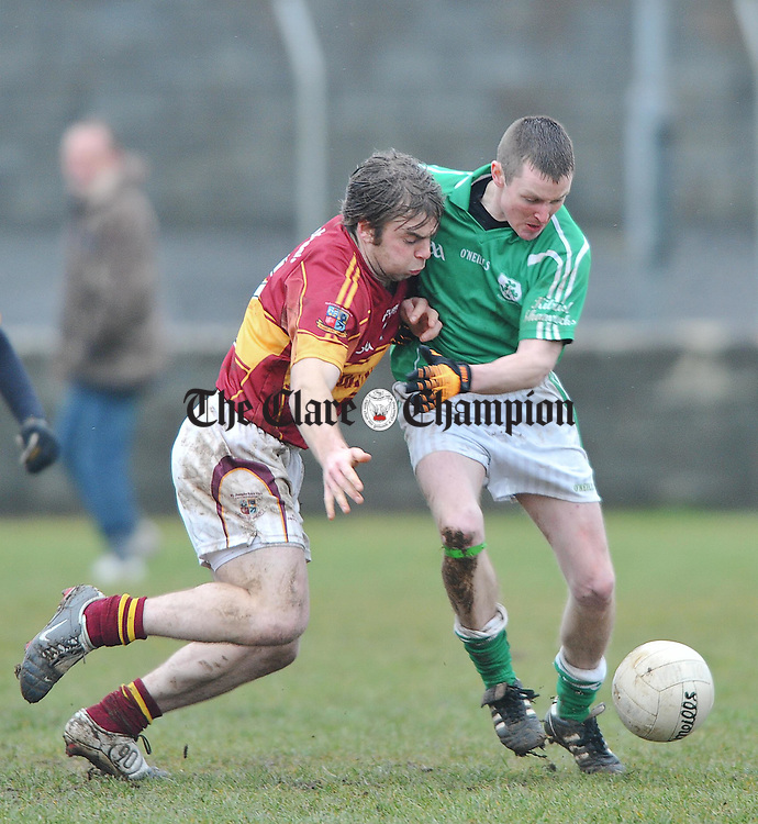 Enda Malone of St Joseph's Miltown in action against Ruaidhri O Connor of Kilrush Shamrocks during their Cusack Cup game in  Miltown Malbay. Photograph by John Kelly.