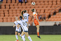 Houston, TX - Saturday July 08, 2017: Celeste Boureille and Janine Beckie go up for a header during a regular season National Women's Soccer League (NWSL) match between the Houston Dash and the Portland Thorns FC at BBVA Compass Stadium.