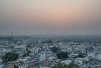Sun rises in the distance over the city of Medak, Telangana, India.