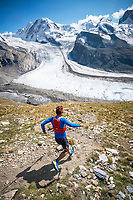 Trail running down a steep trail off the Gornergrat, with Monte Rosa in the background. Zermatt, Switzerland.