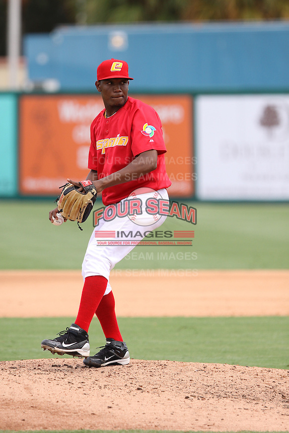 Sammy De Los Santos of Team Spain delivers a pitch to the plate against Team Israel during the World Baseball Classic preliminary round at Roger Dean Stadium on September 21, 2012 in Jupiter, Florida. Team Israel defeated Team Spain 4-2. (Stacy Jo Grant/Four Seam Images)