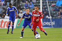 Julio Martinez .Davy Arnaud (blue)...Kansas City Wizards played to a 2-2 tie with Chicago Fire at Community America Ballpark, Kansas City, Kansas.