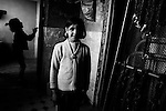 Nestan (9 years old) was born in tent camp for refugees and now lives in a hostel. Helps out her family to collect empty bottles out of the street for earnings. Ganja, Azerbaijan. 2011.( from Hometown project.)