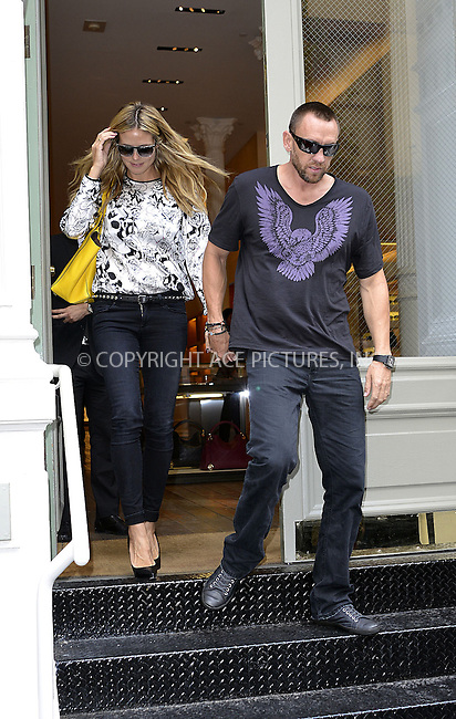 WWW.ACEPIXS.COM<br /> <br /> <br /> June 11 2013, New York City<br /> <br /> Heidi Klum and Martin Kristen hwent shopping in Soho on June 11 2013 in New York City<br /> <br /> By Line: Curtis Means/ACE Pictures<br /> <br /> <br /> ACE Pictures, Inc.<br /> tel: 646 769 0430<br /> Email: info@acepixs.com<br /> www.acepixs.com