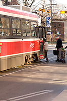 Commuters getting on a street car