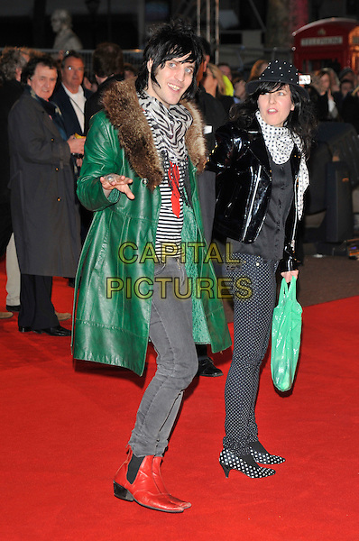 "NOEL FIELDING & GUEST .Attends the UK Film Premiere of director Martin Scorsese's  ""Shine A Light"" documentary about The Rolling Stones, held at Odeon cinema, Leicester Square, London, England,  .2nd April 2008.full length green leather  fur collar trimmed coat hand waving gesture tights grey jeans red boots black and white striped top scarf.CAP/PL.©Phil Loftus/Capital Pictures."
