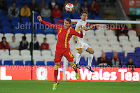 Cardiff City Stadium, Friday 11th Oct 2013. Chris Gunter of Wales battles for a high ball during the Wales v Macedonia FIFA World Cup 2014 Qualifier match at Cardiff City Stadium, Cardiff, Friday 11th Oct 2014. All images are the copyright of Jeff Thomas Photography-07837 386244-www.jaypics.photoshelter.com