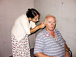 Audiologist assessing patient's hearing