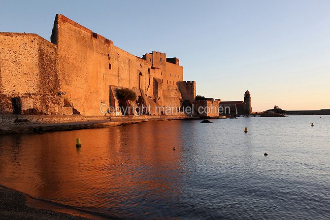 View from the Port D'Avall beach of the Chateau Royal, Collioure, France, with the Eglise Notre Dame des Anges (right) in the distance. Much of the castle was built in the 13th and 14th centuries by the Dukes of Roussillon and the Knights Templar. In the 16th century Collioure was under Spanish control and Philip II modernised and reinforced the castle. It was taken by the French in 1659 after which the bastions were built by Vauban (1633-1707). Picasso, Matisse, Derain, Dufy, Chagall, Marquet, and many others immortalized the small Catalan harbour in their works. Picture by Manuel Cohen.