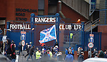 Supporters arrive for the match at Ibrox Stadium