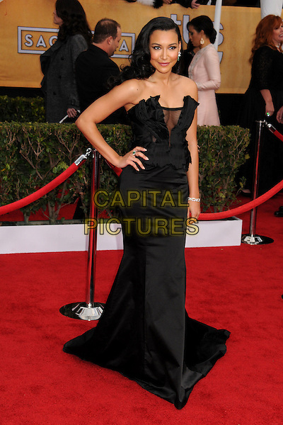 Naya Rivera (wearing Donna Karan).Arrivals at the 19th Annual Screen Actors Guild Awards at the Shrine Auditorium in Los Angeles, California, USA..27th January 2013.SAG SAGs full length black strapless dress satin silk corseted corset gown sheer accordion pleating decolletage hand on hip cleavage .CAP/ADM/BP.©Byron Purvis/AdMedia/Capital Pictures